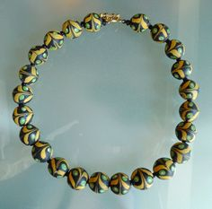 Kathleen McCabe-Elsey, Don'Kay Designs ~ Venetian black, green and yellow feather beads  from the early 1900′s.  595$