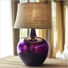 Light things up in any room by finding a spot for this luxe purple lamp base (modeled after an old wine jug) that adds color without hindering sophistication