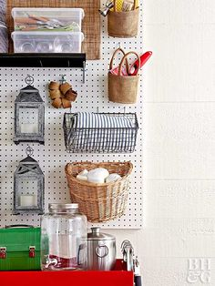 Pegboard isn't just for hammers and screwdrivers. Outfitted with a combination of hooks and baskets, it can store all of your outdoor party essentials. You can purchase baskets made specifically for pegboard, but any wire, open-weave, or handled basket works—as long as you can hang it on a hook. To hang oversize candle lanterns, use two-prong straight hooks that are slightly longer than the depth of one lantern.