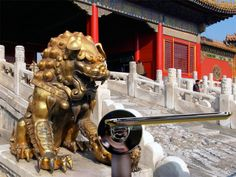 the golden guardian lion keeps an eye on the 'slim' handle by studio spalvieri / del ciotto while traveling through the forbidden city, beijing