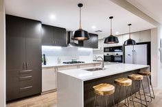 SH Design// The striking kitchen in our 'My Sanctuary' display home at Springtime Estate, Haynes open Sat & Sun 1-5pm. #perthinteriors #kitchen #timber #black #essastone #bosch #laminex #displayhome #homeopen