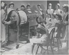 1958- instructing nurses on the use of a respirator for a polio patient.