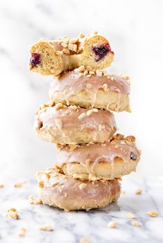 Your childhood favorite just got a makeover: Peanut Butter and Jelly Donuts stuffed with jelly and topped with peanut butter glaze and chopped peanuts!
