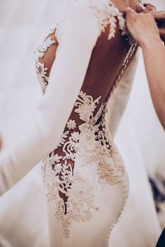 Barcelona Bridal Fashion Week Backstage at Pronovias Model wearing a beautifully embroidered wedding gown with illusion lace details and fitted long sleeves // Before we rev. Dream Wedding Dresses, Bridal Dresses, Revealing Wedding Dresses, Mermaid Dresses, Wedding Goals, Wedding Day, Wedding Beach, Wedding Quotes, Trendy Wedding