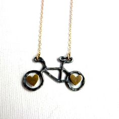 Tiny Bike Gold Hearts Necklace now featured on Fab.