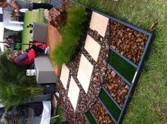 Hard landscaping with a variety of different aggregates + stone slabs.