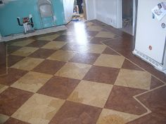 DIY:  How to Get this Checkerboard Floor Design - using paper bags, Mod Podge, tape, stain and varnish - via Simon Says