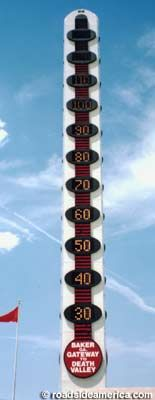 """The World's Largest Thermometer is 134-ft.-tall, symbolic of the record high temperature in the US, in Death Valley -- 134 degrees Fahrenheit in 1913.    It juts up next to Bob's Big Boy in Baker, a small town near Nevada, """"Gateway to Death Valley."""""""