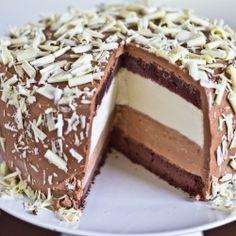 Tuxedo Cheesecake: Layers of white chocolate mascarpone, chocolate swiss buttercream and fudgy chocolate cake.