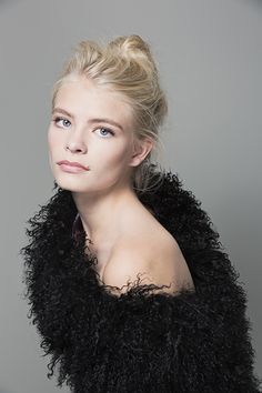 """HCT Mongolian """"Wear 3 Ways"""" Shawl worn off the shoulder in Onyx available here http://heathercampbelltextiles.com/collections/furs"""