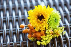 Men's boutonniere orange, yellow and green #storybookweddings Coffee berries, mums, and mini sunflower