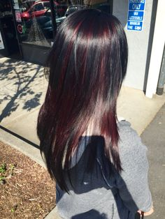 All over dark brown with red violet peekaboo highlights.