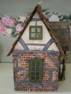 This is Frog's cottage all done. I love how cozy it turned out. The colors are very fall like.  That's glitter in front of the fairy door.  ...