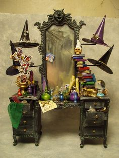 Witch dresser with her many hats. I like the idea of a theme vanity to display character's personailty