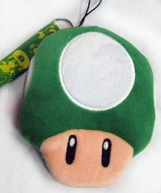 Mario Bro: Coin Purse and Wallet - Green Mushroom by Super Mario Bros. $8.99. This is a cute coin purse from the popular Mario Brother game series! The plush wallet is shaped like a Green Mushroom! The single zipper pocket is about 5 x 4-inches. It is the prefect size to carry a few bills, coins, or cards everyday! Also attached is a Red Mario series lanyard perfect for travel!  Dimension & Measurement: Approximately 5 x 4-inches