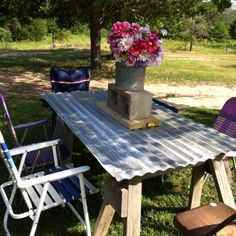 Redneck table with sawhorses and tin.  Minnow can and cinder block centerpieces