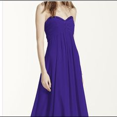 """purple strapless chiffon dress Gorgeous shade of purple, worn once as a bridesmaid's dress. Would work well for prom or could be shortened for a cocktail dress. Beautiful beading and pleating at the neckline. Very flowy and forgiving. Zip closure with hook and eye in the back. I am 5'6"""" and did not need to hem this gown when worn with heels. Make me an offer! David's Bridal Dresses"""