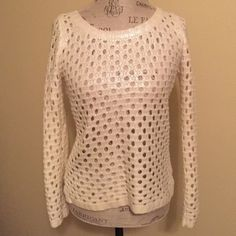 Olive and Oak Shimmer Sweater❄️ Beautiful Olive & Oak open knit sweater. White long sleeve sweater with a pretty shimmery iridescent coating! Tag says small but will fit a XS or Small. High low cut in front and back. Cute with a colored tank or blouse underneath. Great all season sweater. Cute!! Olive & Oak Sweaters