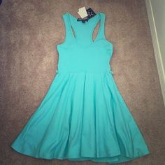 ☀️☀️Aqua blue skater dress. NWT. Great dress, never worn. Has belt loops for a skinny belt. Racerback.✨I do custom bundle discounts, ask me for pricing before buying✨Offer away, but please don't lowball. Charlotte Russe Dresses