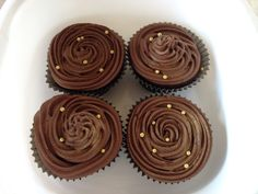 Double Chocolate Fudge Cupcakes with Chocolate Fudge swirls, Decorated with Gold draftees and Lustre Dust. Made by me Elena Purton.