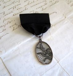 Mysterious Black Lace Medal Lapel Pin by ThatOldBlueHouse2 on Etsy, $44.00