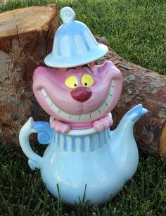 Cheshire Cat Cookie Jar--  Alice in wonderland party decor.  Used this cute cat as one of the centerpieces on my Mad Hatter's table.  Get your own at: www.madinwonderland.etsy.com