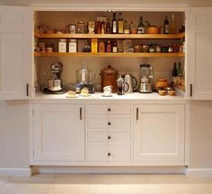 Pale grey kitchen with fitted storage bi fold doors gray kitchens magnificent larder kitchen larder cupboard designed by giles slater for figura a large pantry cupboard within the wall with generous bi fold doors planetlyrics Images
