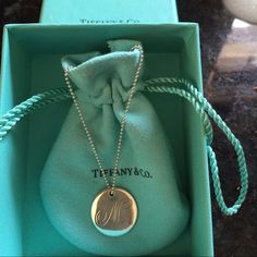 2bdb2662de11 Shop Women s Tiffany   Co. Silver size OS Necklaces at a discounted price  at Poshmark. Description  Sterling silver Tiffany initial pendant and chain.