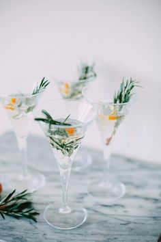 Winter Champagne CocktailYou only need a squeeze of orange juice, a dash of orange bitters, and a pretty sprig of rosemary to make a beverage this elegant. #refinery29 http://www.refinery29.com/champagne-cocktails-recipes#slide-2