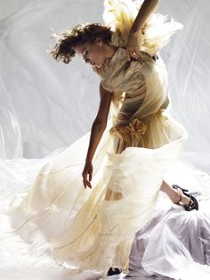 Could she twirl away the madness?  Victoria Beckham - Nick Knight - April 2008 issue