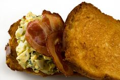 A classic egg salad sandwich topped with crispy bacon and served on rich brioche.