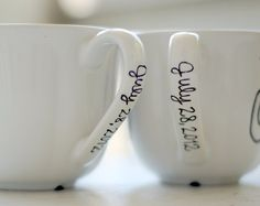 mr. and mrs. last name coffee mugs - wedding date on handle - set of two (2) black and white hand painted design. $60.00, via Etsy.