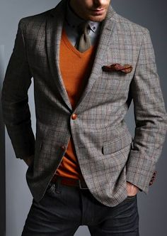 Consider wearing a grey plaid wool blazer and black jeans for a work-approved look.  Shop this look for $182:  http://lookastic.com/men/looks/jeans-and-belt-and-v-neck-sweater-and-pocket-square-and-tie-and-longsleeve-shirt-and-blazer/4134  — Black Jeans  — Burgundy Leather Belt  — Orange V-neck Sweater  — Burgundy Floral Pocket Square  — Grey Tie  — Grey Longsleeve Shirt  — Grey Plaid Wool Blazer