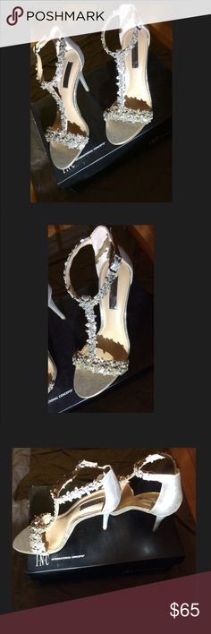 I.N.C Woman's Rosiee Stilettos Gold Pearl T Strap Round open toe T-Strap dress Sandal  Adjustable buckle at ankle strap  Rhinestone and glitter flower embellishment  Padded sock for added comfort  Heel height: 3-3/4 wrapped heel I.N.C Shoes Heels