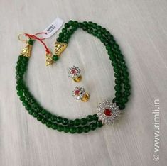 A bottle green beaded choker with zircon findings.