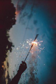 Sparklers in the dark dark sky night clouds fireworks hand