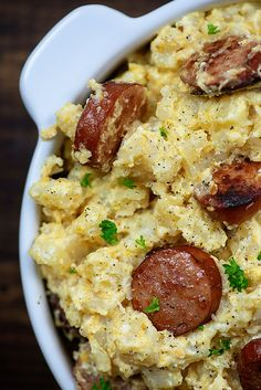 Crockpot cheesy potatoes and smoked sausage is one of those slow cooker casseroles that gets gobbled up every time. It's extra cheesy comfort food at it's finest! #bunsinmyoven