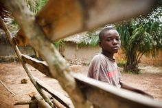 """Achille (age 12) sits in Koaro Village, near the Liberian border. He and his family fled to Liberia to escape the violence that erupted after the November 2010 presidential election. They returned to find their home had been damaged and looted. """"They took everything,"""" Achille said. """"They stole all my books."""" - Côte d'Ivoire, 2011 ©UNICEF/ Olivier Asselin - http://www.unicef.org/photography"""