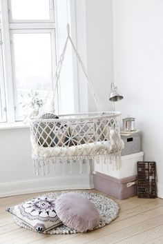 Super cute suspending/hanging crib for a baby girl's nursery. Gives it a very feminine and chic feeling.