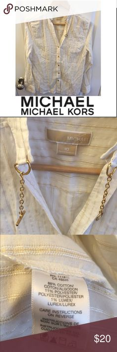 Michael Kors Gold Toggle Button Down Top Michael Kors Gold Toggle Button Down Top. Metallic gold and white stripe. 19.5 in bust. 25 inches long. Gently worn. Great condition. Logo on the buttons. Feel free to make an offer. Tops Button Down Shirts