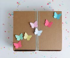 Pinner says: Looking for a simple way to dress up your gift packaging? Take a cue from A Pretty Cool Life, who used #marthastewartcrafts butterfly punches to decorate this craft box!