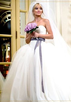 THIS DRESS. This has always been my obsession, I HAVE TO HAVE A similar dress... I think It's a real designer. This is Kate Hudson in the movie Bride Wars.