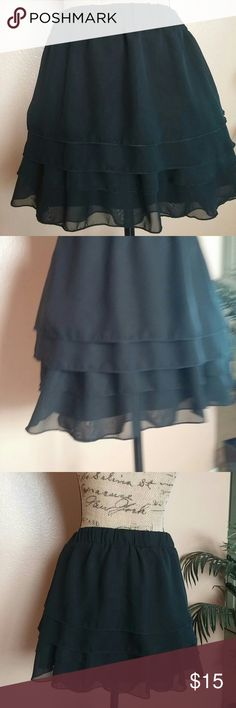 My little black flirty flouncy ruffle skirt So fun and flirty is this little black skirt. Elastic waist. 4 rows of soft ruffles. Lined. Beautiful cond. Polyester. Catch My Skirts