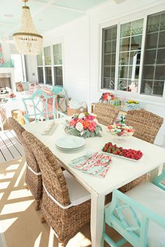 Such a happy and colorful back porch - tangerine and turquoise elements.  Love it!