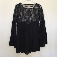 Tobi lace dress Brand new lace detailed long sleeve dress in perfect condition. Sheer top half but can be paired perfect with a cami or bralette. Flowy and classy and super cute Tobi Dresses Long Sleeve