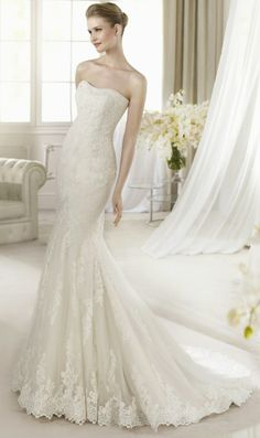 San Patrick #Atlanta strapless wedding gown with a trumpet silhouette with embroidered lace and a softly dipped neckline with a skirt that sweeps into a full length train in a size 16 for $1195 at #LeDressBoutique