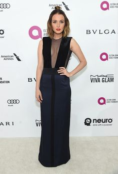 Camilla Luddington Evening Dress - Camilla Luddington attended the Elton John AIDS Foundation Oscar viewing party wearing a two-tone column dress with a cleavage-revealing panel.
