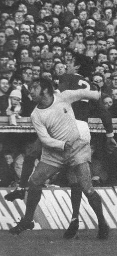 8th November 1969. Manchester United full back Shay Brennan out jumping Coventry City playmaker Ernie Hunt, at Highfield Road.