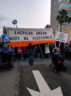 """""""American Dream Must Be Accessible,"""" """"No body left behind,"""" at the Oakland Women's March, January 21, 2017.  Photo credit: @lizhenry, on Twitter"""