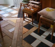 a mix of old colored tiles and beautiful parquet flooring